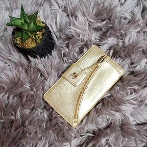 Gold patent leather bifold wallet